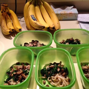 3 oz. of chicken, 40 g. brown rice pasta and unlimited mushrooms and spinach in each container with a sprinkle of parmesan